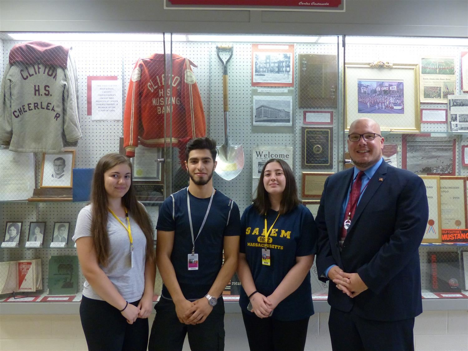 CHS Students with Dr. Robertozzi in front of display case
